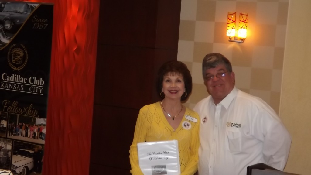 John Rau presents a new member welcome packet to Susan Phillips