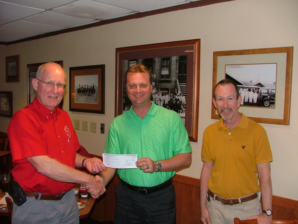 Dan Boyer presents a $1000 gift to Club President Steve C