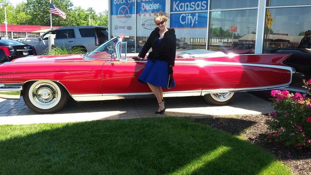 What would a Cadillac car show be without our gal?