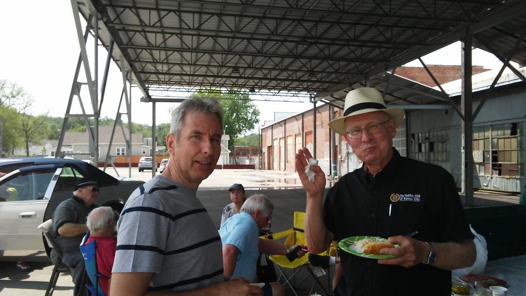 Club President, Steve (right), enjoys a hot dog