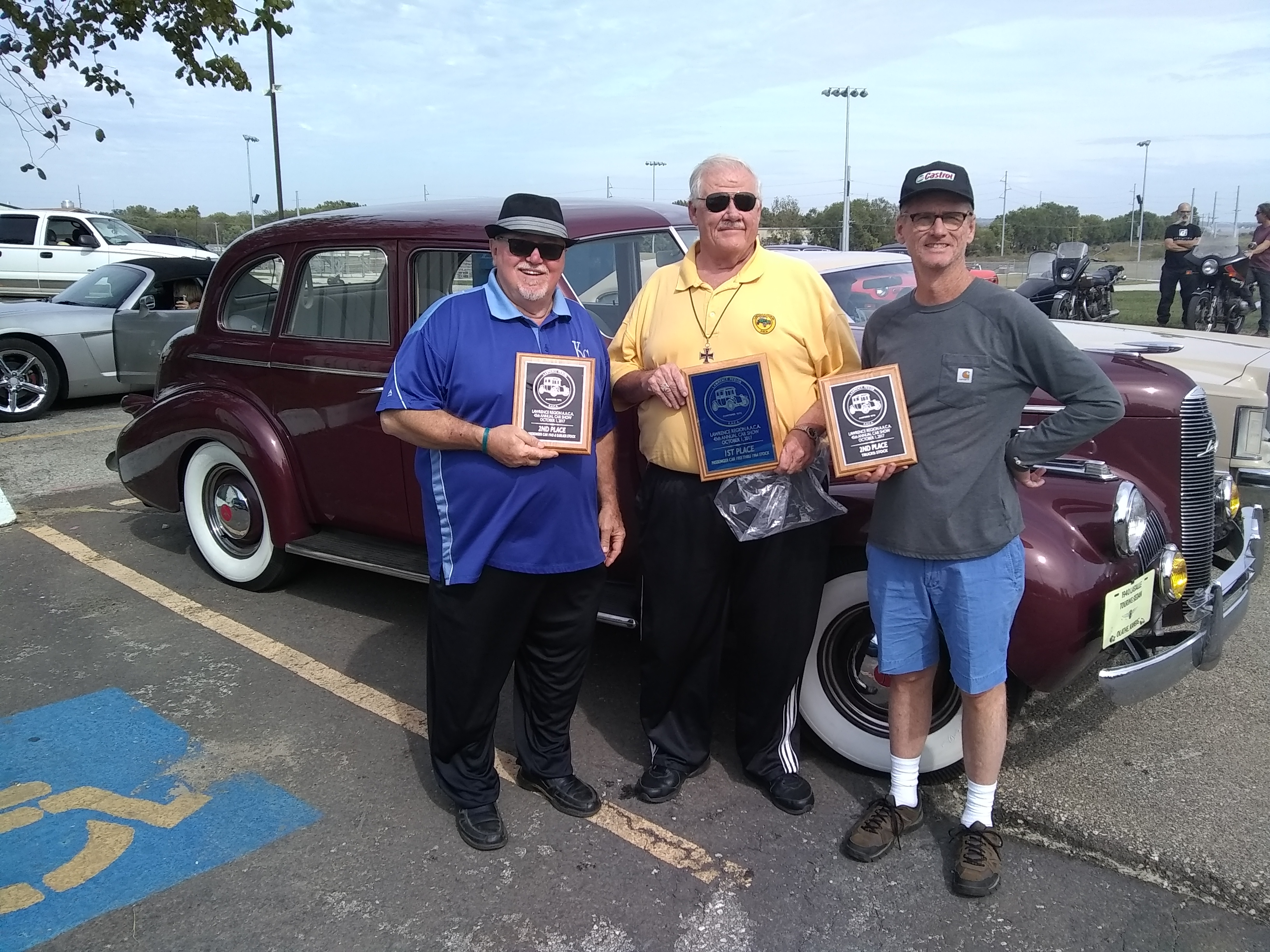Tom, Norm, and Tom bringing home the hardware